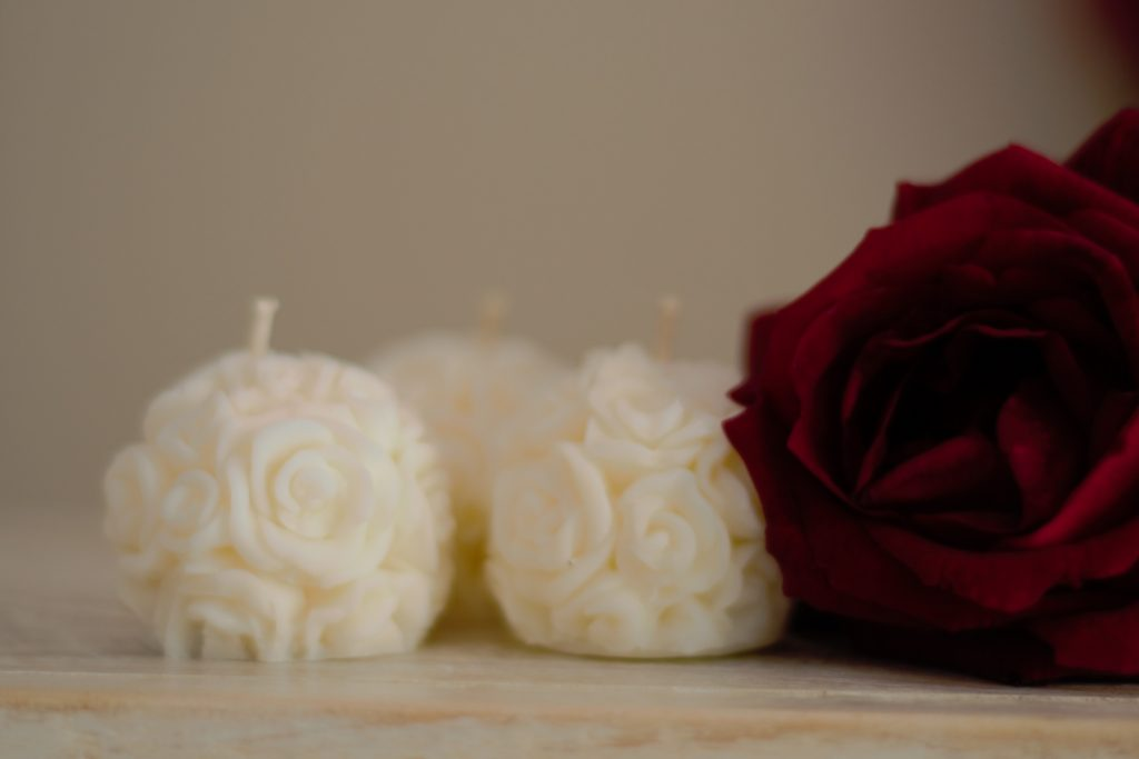 Decorative rose candles, group of 3.