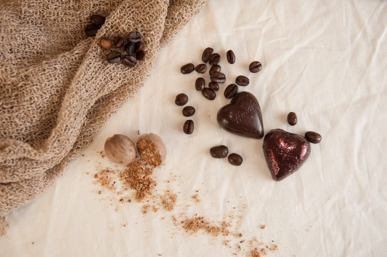 Chocolates, coffee and spices laide amongst hessian.