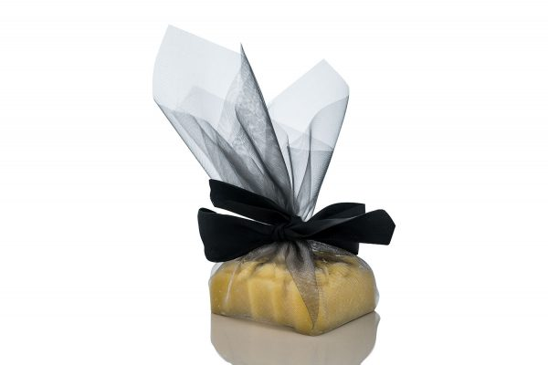 Organic Cocoa Butter, Chocolate and Orange massage bar packaged in transparent black fabric with a black ribbon.